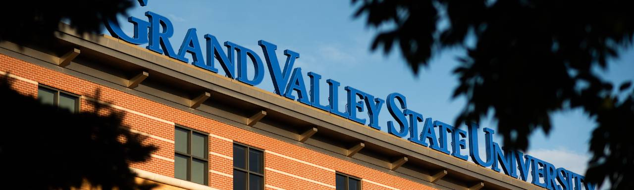 Grand Valley State University sign on building on Pew Campus
